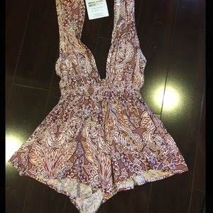 Cute & little scandalous romper for a night out!